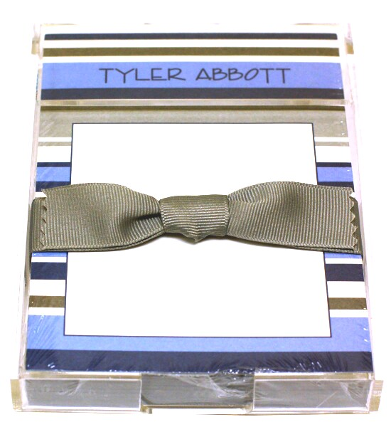 Blue & Silver Stripe Notepad - Stylish personalized gift idea!  Personalized notesheets with acrylic holder and grosgrain ribbon.DETAILS:Available BLANK (no text) or PERSONALIZED (2 lines of text)150 designer note sheets shrink wrapped and tied with coordinating grosgrain ribbon.For personalized, select your choice of font and font color.  Specify 2 lines of text which can be formatted like any of the samples shown.Blank and personalized sheet refills also availableFont and font color shown on sample:  ENCINO & BLACK