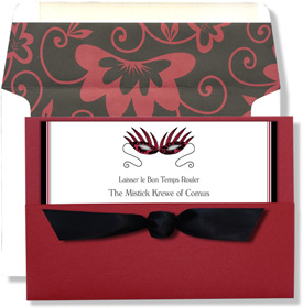 "Masquerade Elegant Pocket With Bow - Elegant sparkle cardstock! Imprintable white cardstock with a black and red costume mask and a black and red border and inserts into a red sparkling pocket.  The card is 7.75"" x 5.25"" and has a black satin bow that ties onto the pocket. The coordinating white envelope has a black and red floral design on the internal flap. It is an ideal choice for a Mardi Gras celebration. CUSTOMER ASSEMBLY REQUIRED. We can attach bow for you at a charge of $1.00 each.Can be printed on your inkjet/laser printer or we can print for you.  Includes white envelope lined in coordinating design. Matching reply cards also available."