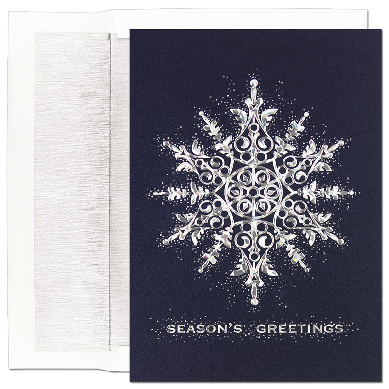 "Refractive Snowflake Greeting Card - Beautiful blue card with a silver metallic star that adorns the front and the wording Season`s Greetings in silver.   The Verse inside of card reads;""  May Every Happiness Be Yours This Beautiful Holiday Season And Every Day In The New Year .""  If you would like us to personalize this card with family name or business name please call for details. Comes with Silver lined envelopes."