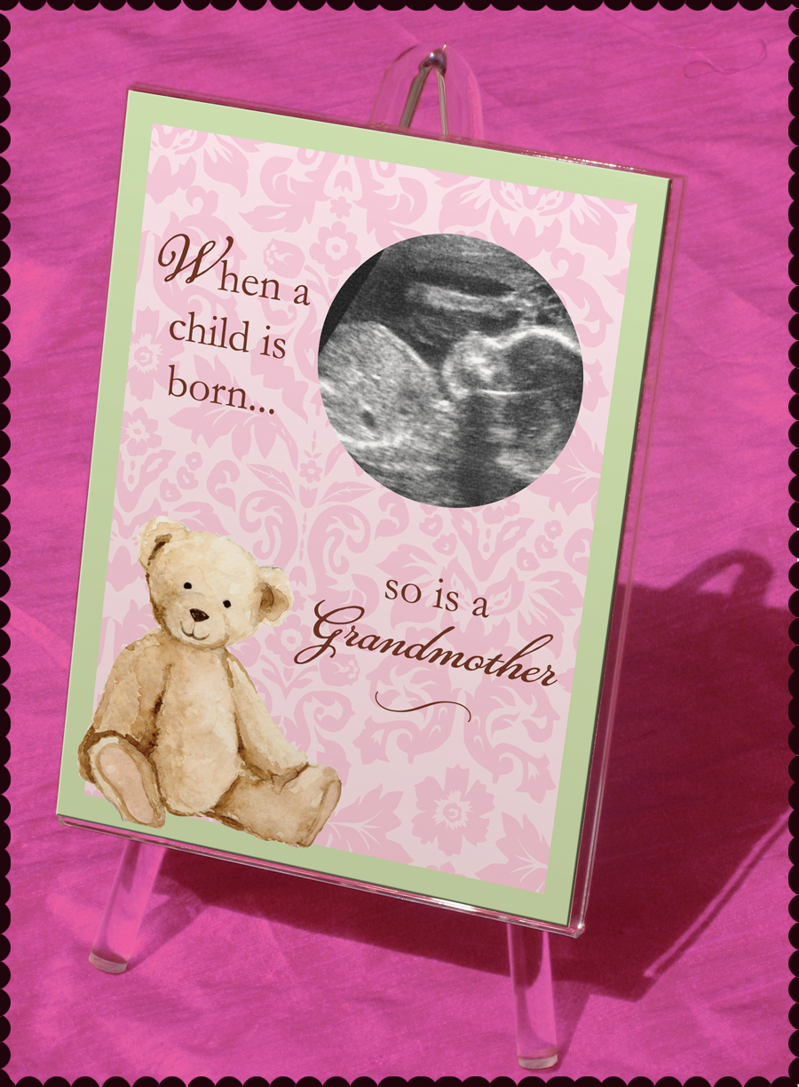 "Grandmother Keepsake Frame - This beautiful keepsake frame is the perfect gift for any Grandmother!  This 5x7"" easel frame shows a cuddly light brown bear with a precious pink damask design on the background with a light green frame aound the edge.  A die-cut window is created to slip a ultrasound picture in.  A Perfect gift for a future grandmother!"