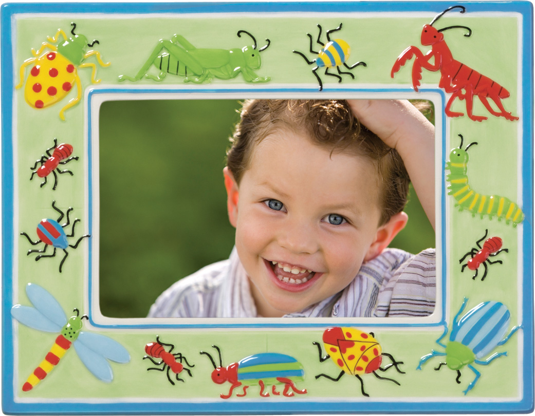 "Insects fun Ceramic Frame  - DiscontinuedA great fram for  your little explorer!  This ceramic frame is designed with a green and blue frame and has lots of crawling insects around the border of the frame.  Perfect for your home or nursery!   Dimensions are 7 x 9 1/16"" and makes a great gift for that new mom to show off her bundle of joy!"