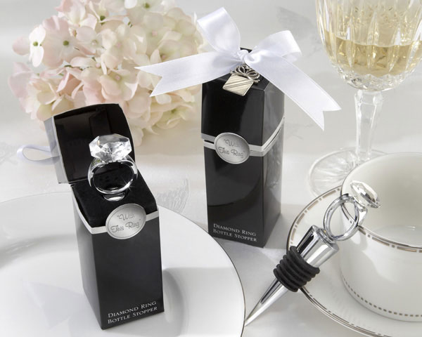 With this Ring Chrome Diamond Ring Bottle Stopper  - You know that feeling you get when hes on his knee and opens the ring box? Wedding guests will get that same rush of excitement when they open this ultra-creative gift box to what else? An engagement ring sitting atop a bottle stopper! A simply breathtaking favor!