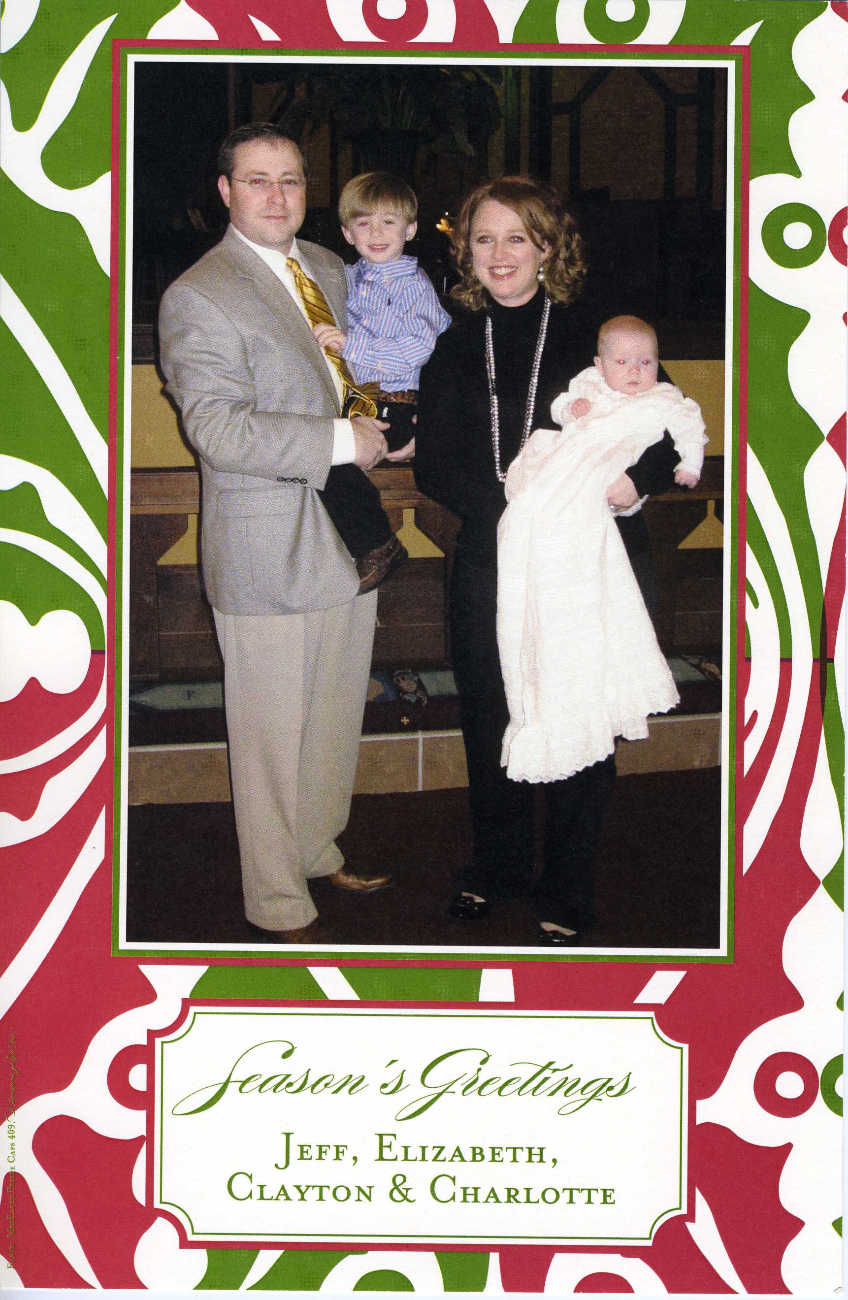 Merry Modern - This elegant holiday photo card features a lovely border in a bold red, green and ivory pattern, with both your photo and text areas framed in decorative red and green.  Includes ivory envelope.