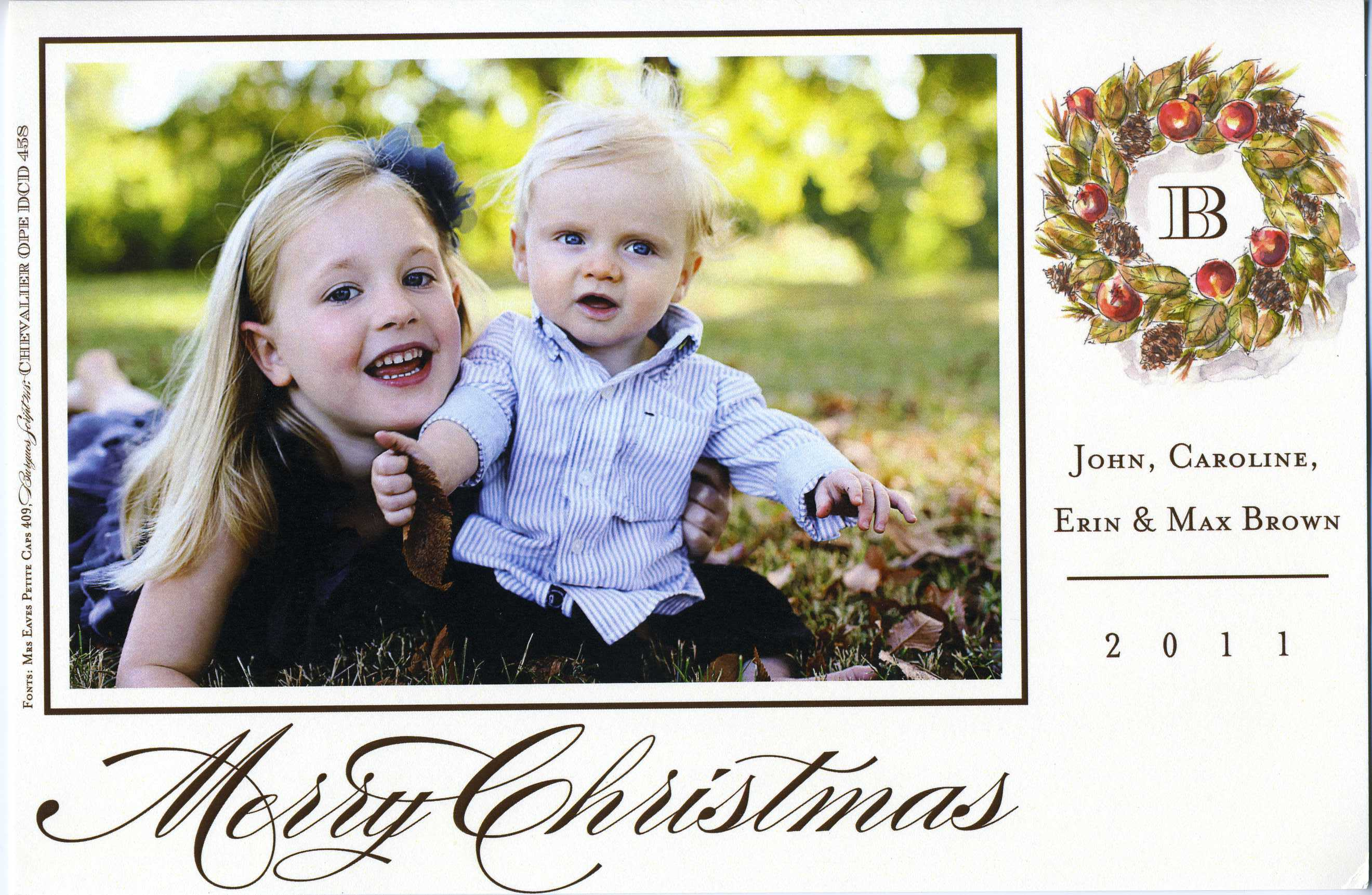 Woodland Wreath Photo Flat Card - This festive photo card features an elegant holiday wreath that frames your familys monogram. The words Merry Christmas are printed with a flourish along the bottom.  Simply attach your photo in the photo box.