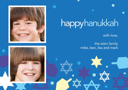 Collage of Stars Photo Card - A lovely holiday photo card perfect for Hanukkah! It is designed with dreidels and stars against a blue background. There is room for two digital photos to be included in the digital design. Keep in touch with those you care about during the holidays with this Hanukkah card! Printed on high quality card stock using crisp digital printing. Includes white envelopes.