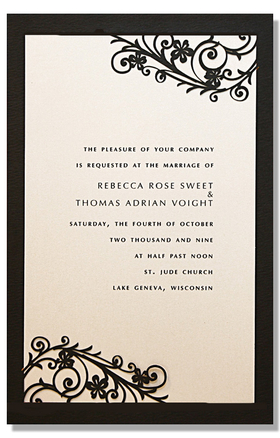 A beautiful black card with a laser-cut scroll and floral design that has a shimmery ivory insert card.  This is perfect for an elegant wedding or formal event. Includes an ivory envelope.