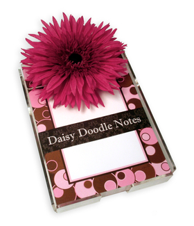 Pink Dots on Brown Daisy Doodle Notepad - A great gift idea!  Comes in bright and fun designs each with 150 loose sheets.  Includes acrylic holder and a large daisy flower.  These notes can be personalized with one line of text and printed in black ink.   Personalization will be printed at the bottom of the notepad above border. <br>
