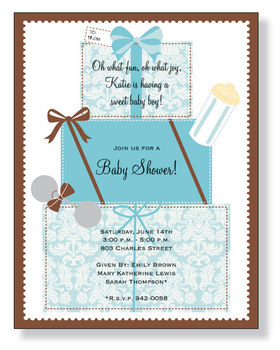 Blue gift boxes that are printed solid blue and also with a blue damask design.  Accented with baby bottles and rattles and all tied together with a chocolate ribbon and a border around the paper.  This makes a great paper for any baby boy shower.<br>
