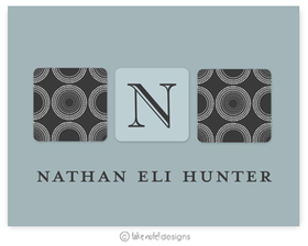 A sophisticated Dark grey note with circular designs on the front and an area to place the Initial of your choice.  Includes white envelopes.