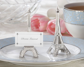 Ooh, la la! Destination Paris. The enchanting City of Light is one of the most romantic places on earth you might even call it the City of Love, and this Evening in Paris Eiffel Tower Place Card Holder is quickly becoming a renowned landmark in the wonderful world of favors. When your event has a distinctly French flavor, favor your guests with a thank-you gift thats magnifique! <br>*Finely detailed, silver-finish replica of the Eiffel Tower <br>*Favor measures 3.75 h  x 1.25 w inches. <br>*Place cards are included<br>*Sold in a set of four <br> <br> <br> <br> <br>