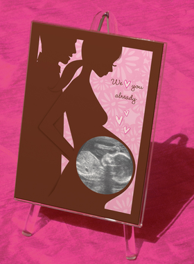Discontinued <br><br>A Beautiful way to show your first photos of the new baby Girl!  This popular bab shower gift is perfect for the mom-to-be.  Comes in an acrylic easel style frame.