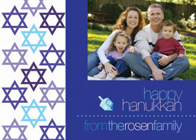 A lovely holiday photo card perfect for Hanukkah! It is decorated with Stars of David along the left border. Your digital photo and personalized wording is set against a blue background and accented with a dreidel. Keep in touch with those you care about during the holidays with this Hanukkah card! Printed on high quality card stock using crisp digital printing. Includes white envelopes.