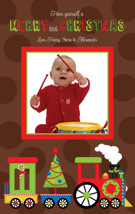 Send out a smile with your holiday greetings this year!  This adorable design features a colorful Christmas train against a fun brown polka dot background.  Your favorite picture is printed in the center. Upload your photo or if you have questions please email customercare@impressinprint.com
