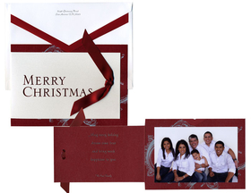 Spread your holiday cheer with these elegant fold-over Christmas photo cards!  The front features the words MERRY CHRISTMAS in bright red foil.  The inside is printed with a festive silver flourish design against a rich red background.  The phrase of your choice is printed in silver foil along with your family name.  You may select up to 3 lines of personalized text.  <br><br>A festive red ribbon is tied to the front flap.  Your favorite photo is easy to attach inside.<br><br>Price includes cards, photos, ribbons, glue dots and white envelopes with red edged flaps.<br><br>Please e-mail a high-resolution file of your photo to customercare@impressinprint.com.<br><br>If you have any questions or need assistance when ordering please call Customer Care at 1-800-804-1960.