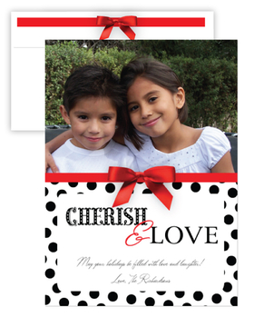 A polka dot black and white background and a fun red ribbon on the front set as to show off your precious gifts of family for this holiday season.  Personalize with your special message to create your custom holiday photo card. Includes a coordinating envelope with a fun red ribbon printed on the side. <br>